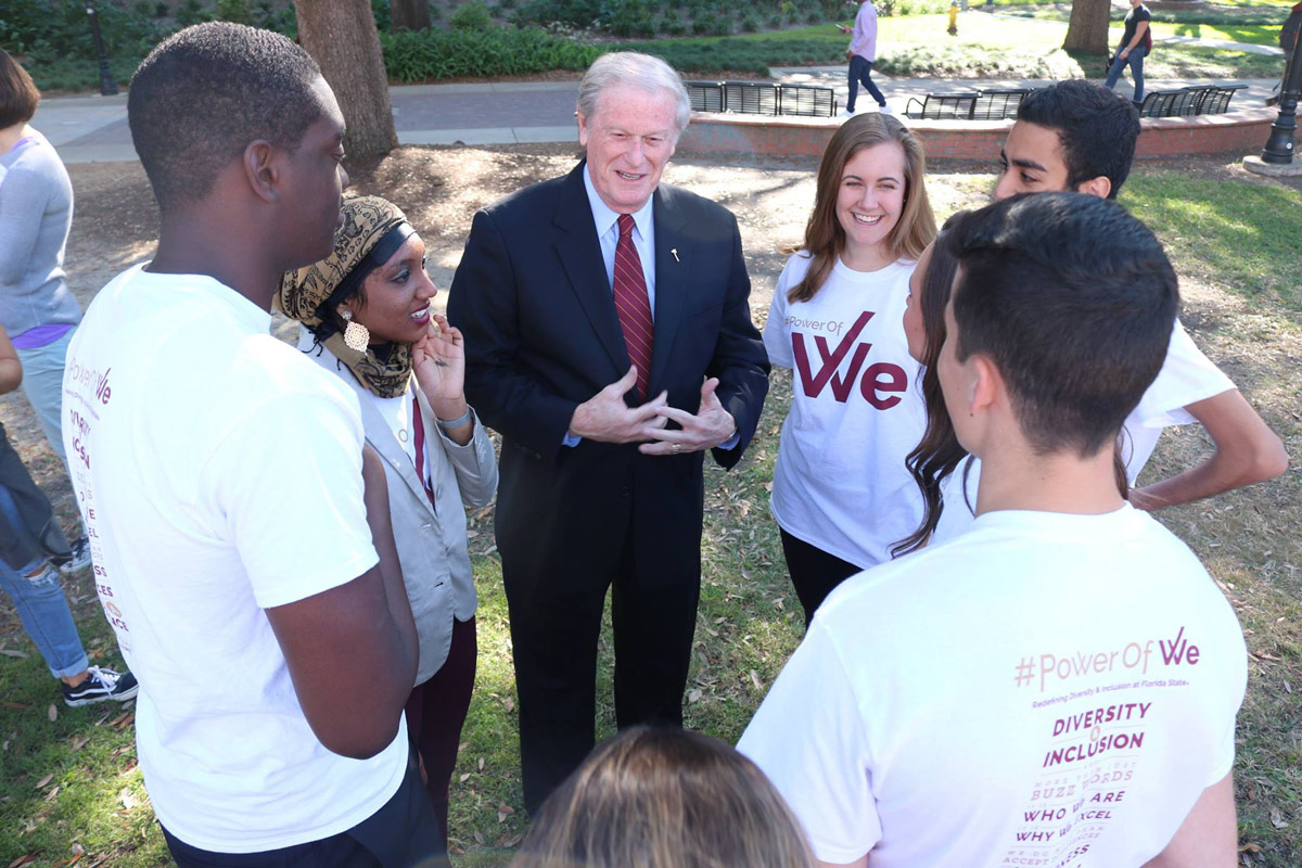 President Thrasher speaking with Power of We students